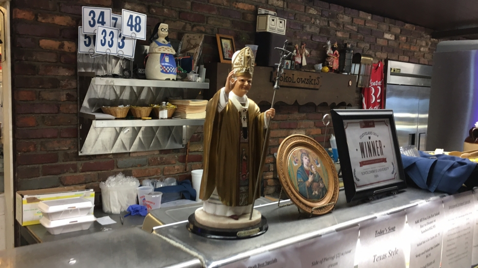 A statue of Saint John Paul II welcomes all who pass by in the lunch line at Sokolowski's.  (Amy Eddings/ideastream)