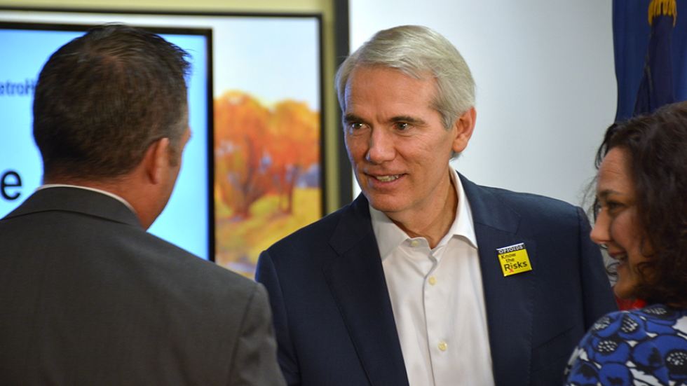 Sen. Rob Portman greets people before speaking about opioid addiction at MetroHealth Medical Center earlier this month.