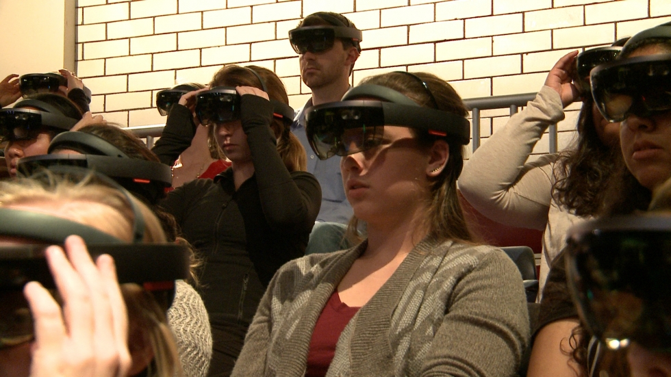 A member of the audience at Case Western Reserve University waits for the dance performance to being with her HoloLens headset on. (Ashton Marra/ideastream)