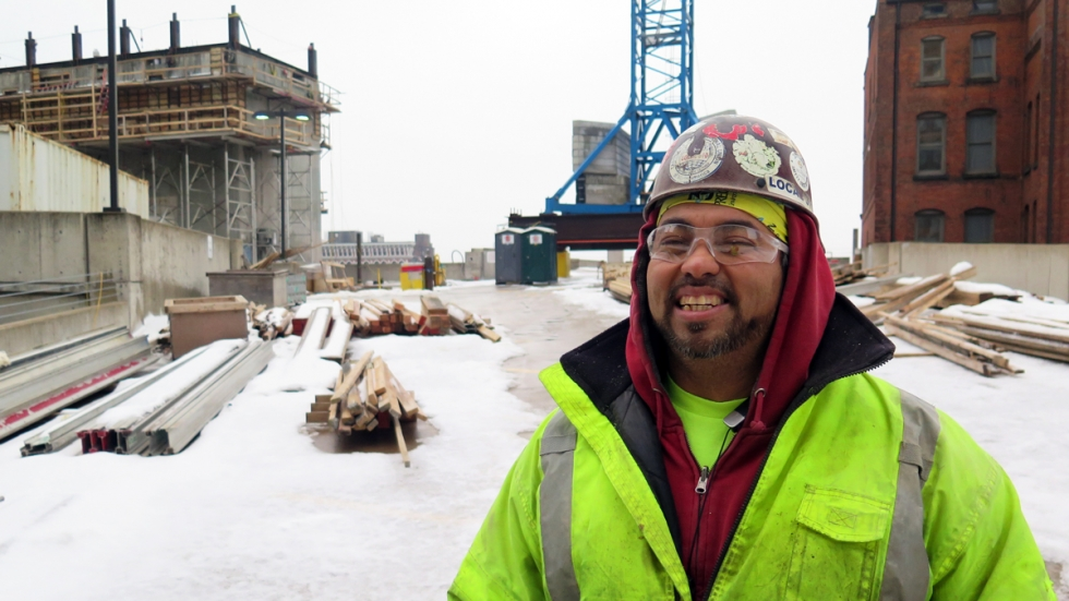 """""""You just gotta suck it up,"""" said Kai Yee, a laborer with Local 310, when asked how he deals with extreme cold. """"If [you] can't do the job, they'll bring somebody else who can. Everybody's replaceable."""" [Adrian Ma / ideastream]"""