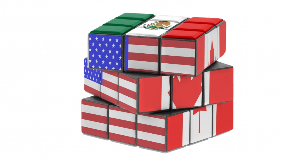 A Rubix cube with the flags of the United States, Mexico, and Canada on its sides. [michelaubryphoto / shutterstock]