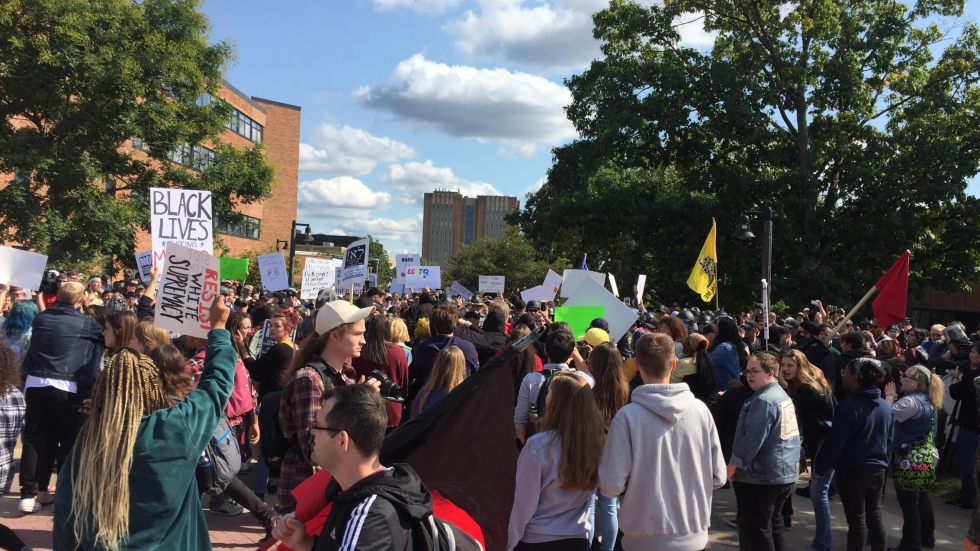 Counter-demonstrators showed up in force for an open carry walk by guns rights advocates on campus on Saturday, Sept. 29, 2018. [ Khabir Bhatia / WKSU ]