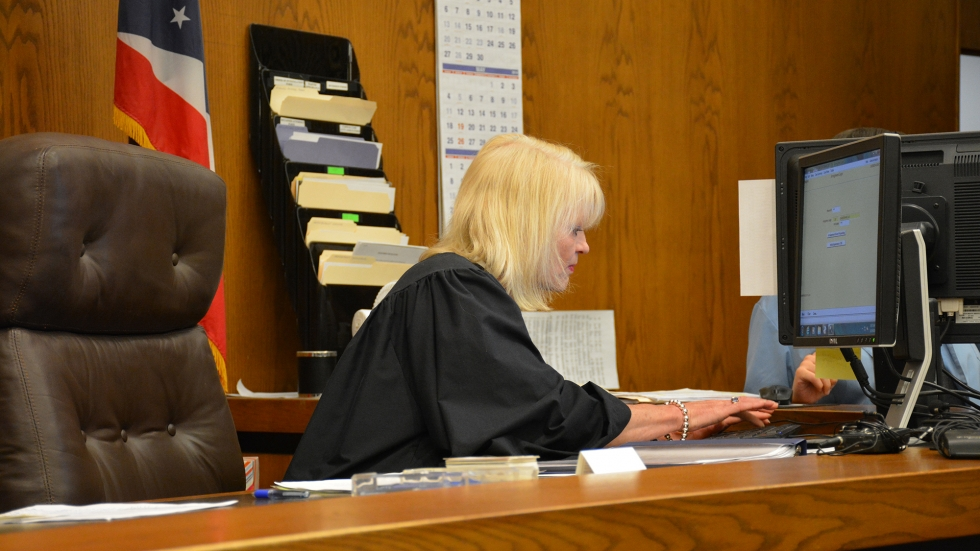 Cuyahoga County Common Pleas Judge Pamela Barker types at a computer in a courtroom in 2014.