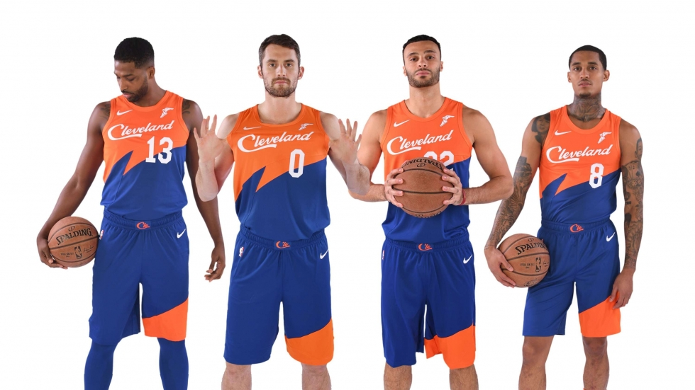 """Four Cleveland Cavaliers players pose in their new """"city"""" uniforms."""