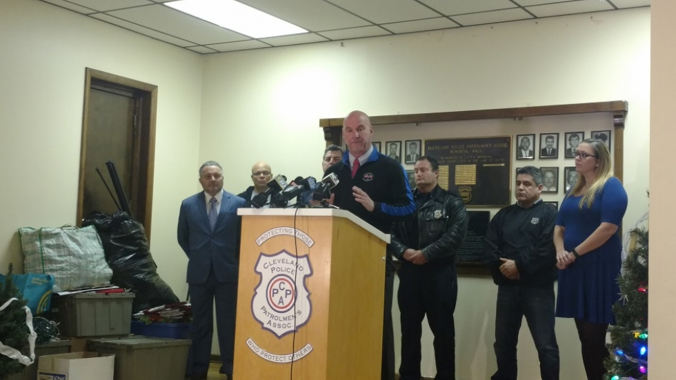 Cleveland Police Patrolmen's Association President Jeff Follmer stands behind a podium.