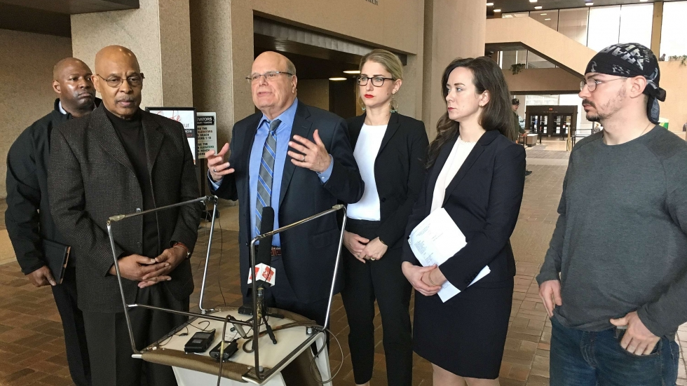 (L to R) Edward Little & James Hardiman of the Cleveland NAACP, Terry Gilbert, Sarah Gelsomino and Jacqueline Greene of Friedman and Gilbert, Leo Kesman a plaintiff at a press conference in the Justice Center lobby.