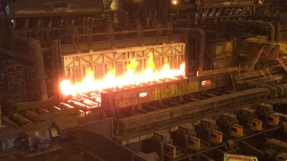 Steel slab coming out of furnace at ArcelorMittal's hot strip mill. [Matt Richmond / ideastream]