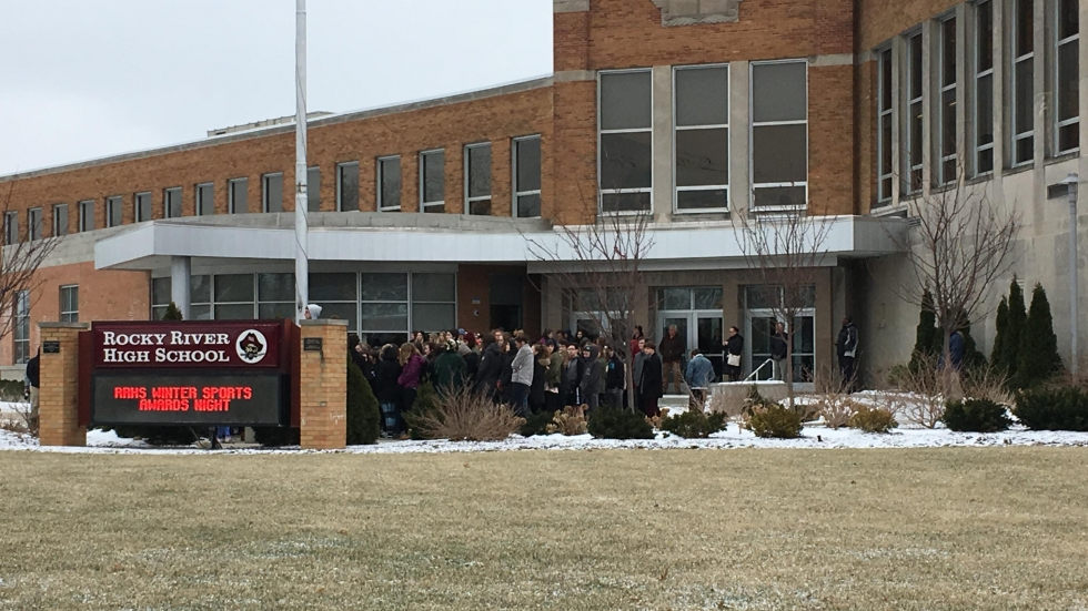 Rocky River High School students gathered under the flag pole for 17 minutes of silence. (Ashton Marra/ideastream)