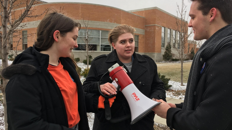 Rocky River High School students Ariel Russell, Haley Reash-Henze and Duncan Feighan talk after the walkout they organized at Rocky River High School Wednesday. (Ashton Marra/ideastream)