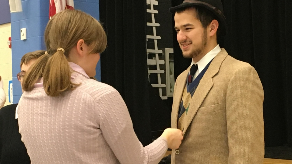 Jacob Berchtold, right, tried on his costume for the first time with a cast mate. (Ashton Marra/ideastream)