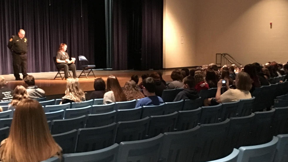 An inmate from the Columbiana County Jail speaks with Lisbon high school and middle school students about the dangers of drug use. (Ashton Marra/ideastream)