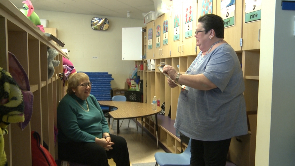Dr. Marilyn Lotas, left, and Director of Nursing and Health Services Debbie Aloshen, right, discuss the progress of the program at Mound Elementary School. (Ashton Marra/ideastream)