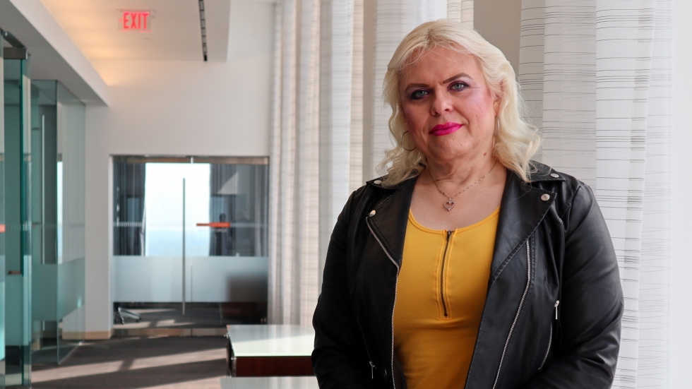 """""""My previous employer, the one I transitioned at, I'll never forget the day I came out to them,"""" said Natalia Hodlik a Senior Technology Specialist at PNC. """"I was shaking like a leaf."""" [Adrian Ma / ideastream]"""