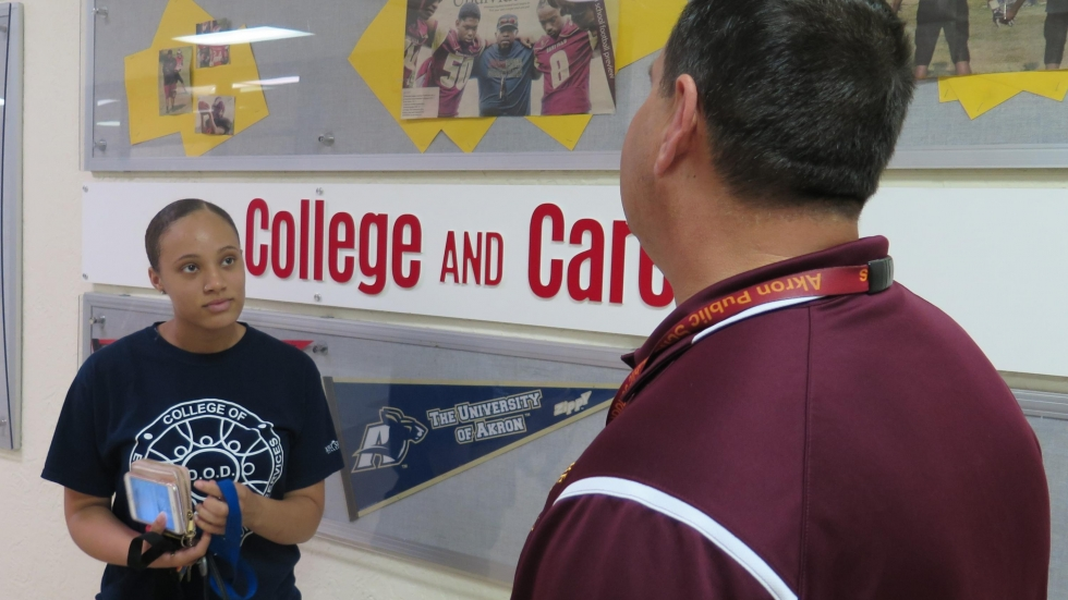 Senior Ja'Mya Goley speaks with Principal Frank Kalain about what college scholarships she should apply for this school year. (Ashton Marra/ideastream)