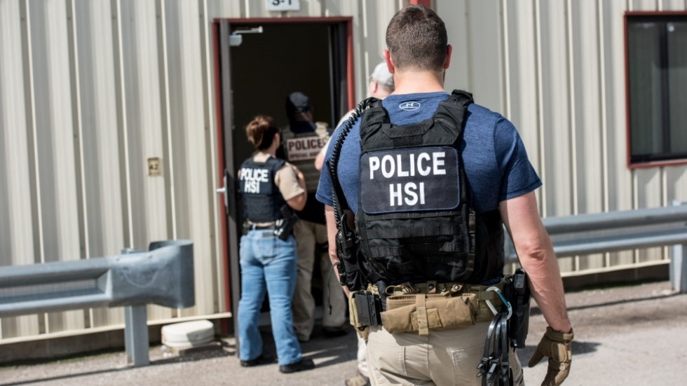 Immigration agents search a Fresh Mark facility in Salem, Ohio, in this photo distributed by the government.