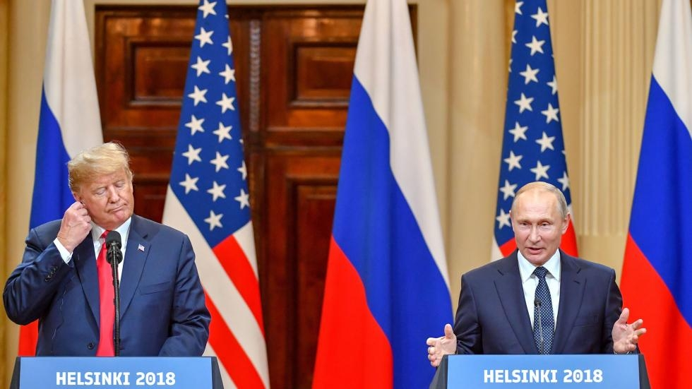 President Donald Trump and Russia's President Vladimir Putin hold a joint press conference after a meeting at the Presidential Palace in Helsinki.