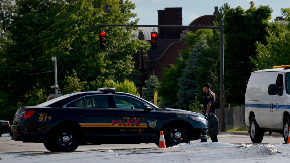 An East Cleveland police officer responds to a water main break in 2014.