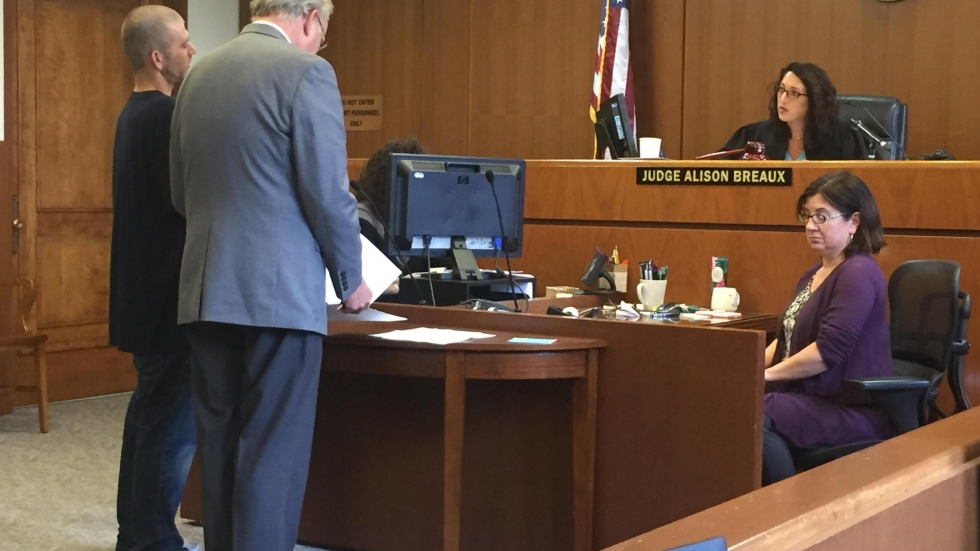 Judge Alison Breaux speaks with defendant James Speigel (left) during the first session of Hope Court. [Lecia Bushak / ideastream]