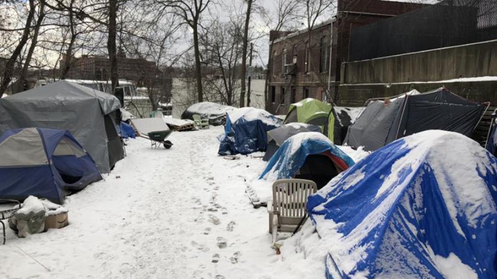 Tents lined up covered in snow in Akron. [The Homeless Charity and Village]