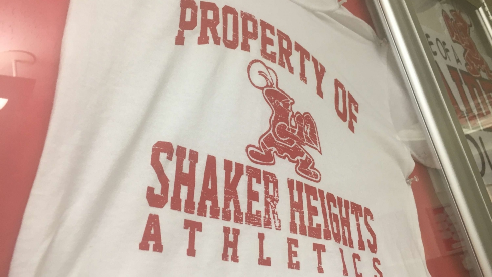 A Shaker Heights Athletics t-shirt hangs in the high school hallway. [Annie Wu / ideastream]
