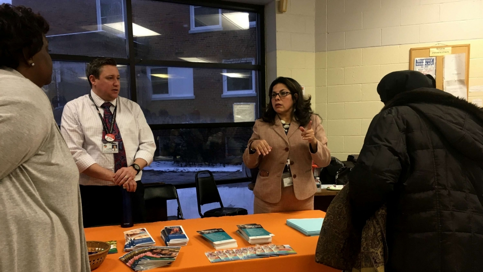 Cuyahoga County staff run an information table at a meeting in Cleveland on children and family services