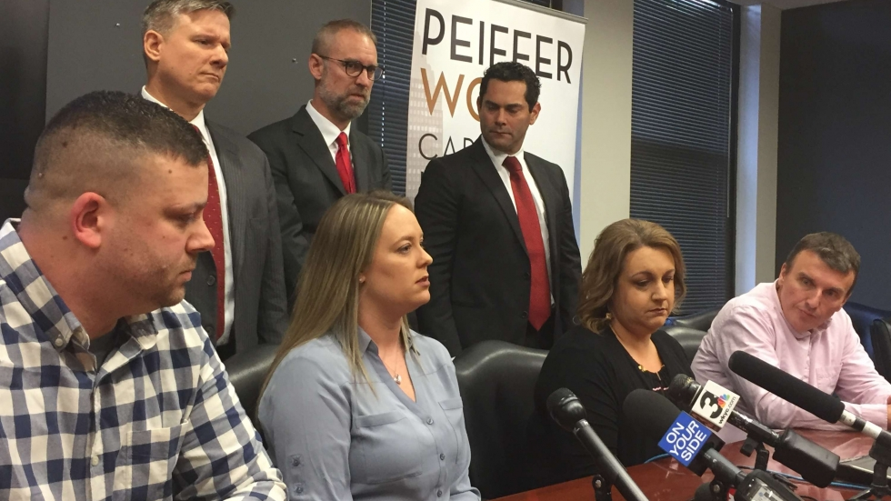 Two couples, Matt and Emily Petite and Kim and Joe Bucar, spoke about their experience losing embryos in the UH fertility clinic malfunction at a press conference announcing new lawsuits. [Lecia Bushak / ideastream]