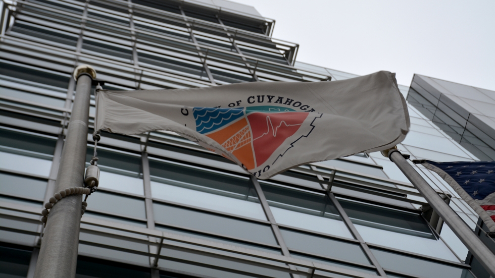 A flag flies at Cuyahoga County's headquarters in downtown Cleveland.
