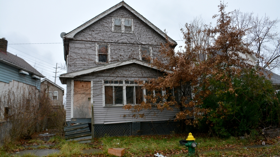A boarded-up house in East Cleveland photographed in December 2018.