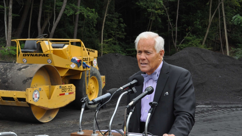 Mayor Don Plusquellic in 2014 at a project to prevent combined sewer overflows [Mark Urycki / ideastream]