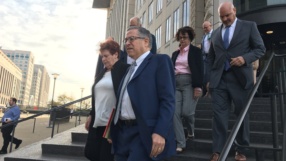 Summit County Executive Ilene Shapiro (left front), Cuyahoga County Executive Armond Budish (right front), Cuyahoga County Prosecutor Michael O'Malley (right back) and other members of the plaintiff's team leave the Carl B. Stokes U.S. Courthouse in Cleveland to announce the tentative Oct. 21 settlement.