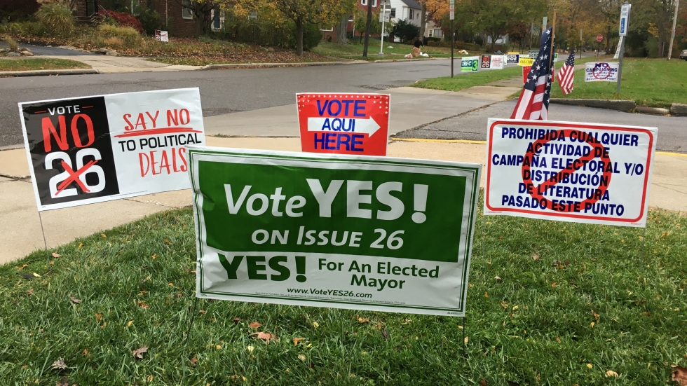 Issue 26 signs outside a Cleveland Heights polling site.