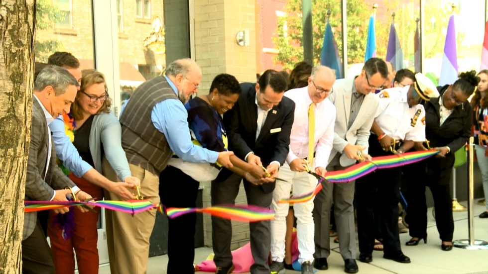 LGBT Community Center staff and community members cut the ribbon at the center's grand opening in June 2019.