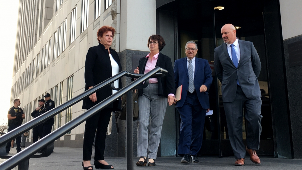 Summit County Executive Ilene Shapiro, Summit County Health Commissioner Donna Skoda, Cuyahoga County Executive Armond Budish and Cuyahoga County Prosecutor Michael O'Malley exit the federal courthouse in downtown Cleveland after settling with drug companies in October.