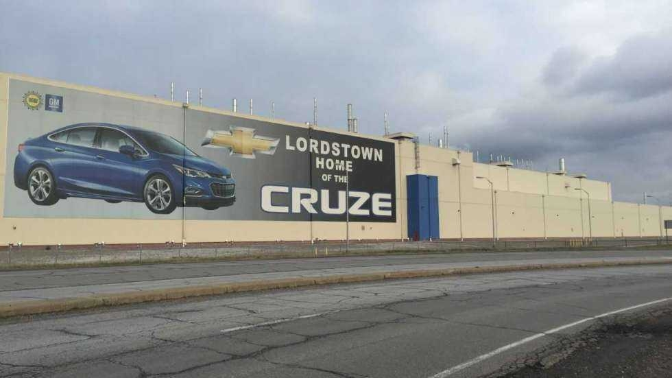 The exterior of the former Lordstown General Motors plant, with an ad for the Chevy Cruze.