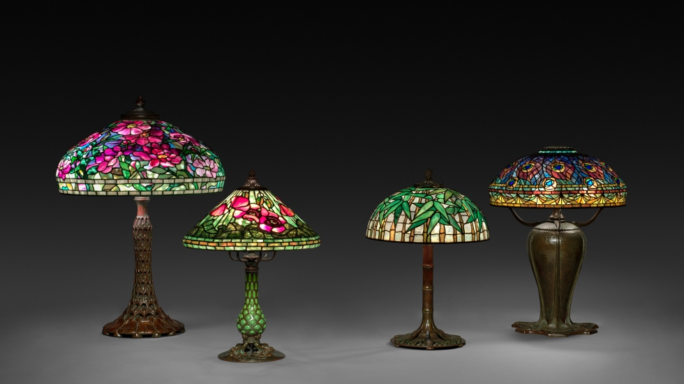 picture of Group of lamps by Tiffany Studios (America, 1902–1932) Bequest of Charles Maurer. Left to right: Peony Table Lamp, c. 1901–10, Poppy Filigree Table Lamp on a Blown-Out Base, c. 1900–1910,  Bamboo Table Lamp, c. 1910, Peacock Lamp, c. 1898–1906, [Cleveland Museum of Art]