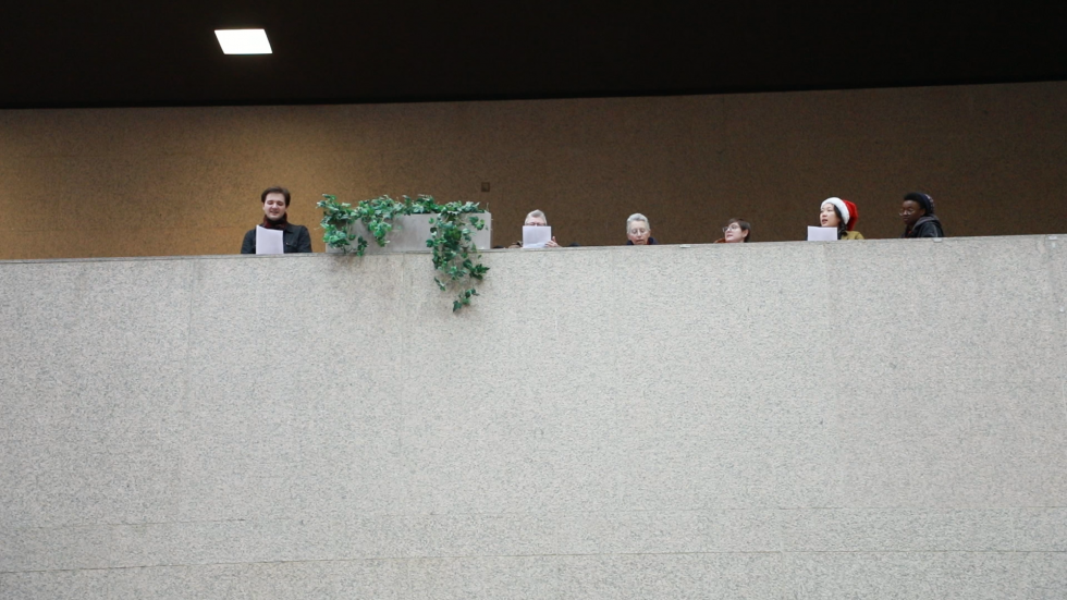 Protesters sang two songs before security escorted them out of the Justice Center. [Jeff Haynes / ideastream}