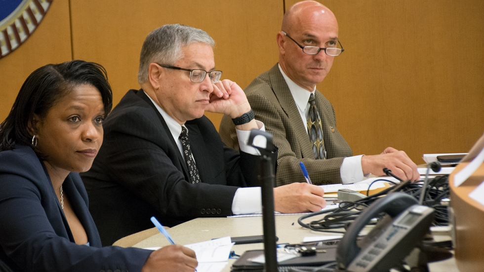 Judge John Russo, right, listens during a meeting on justice reform in October 2019, along with Cuyahoga County Executive Armond Budish and Judge Michelle Earley, the administrative and presiding judge in Cleveland Municipal Court.