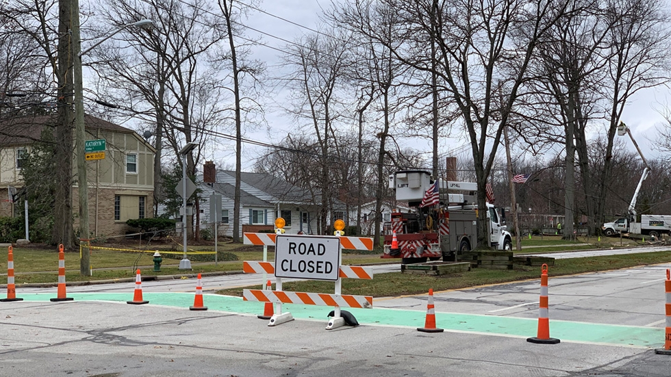work crews clean up and restore power near Clague Park in Westlake Dec. 30, 2019