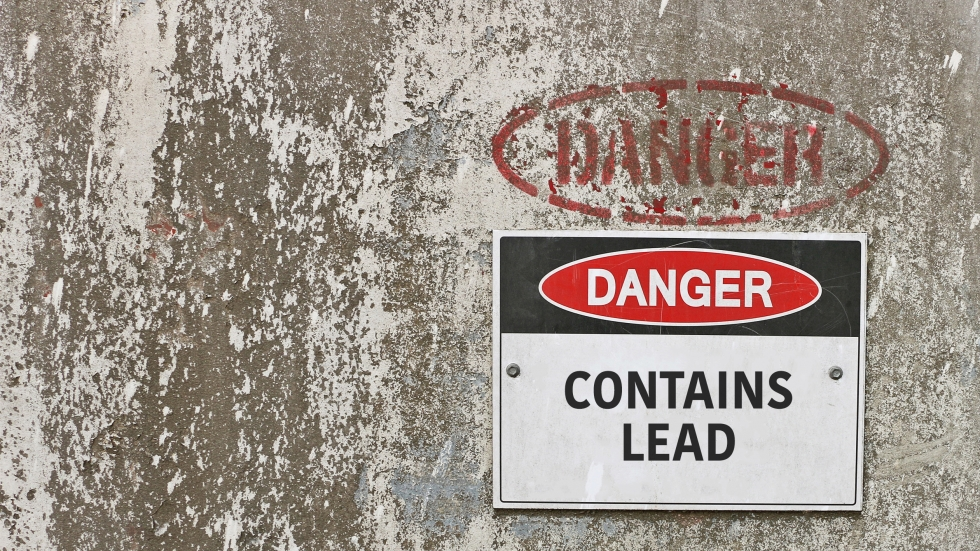 A sign saying danger contains lead.