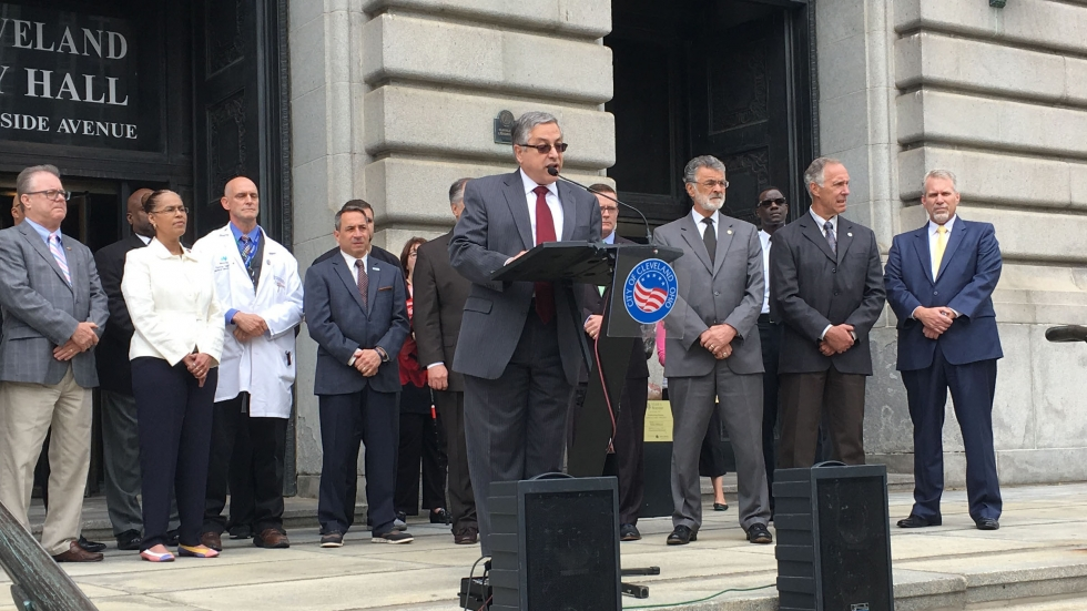 Cuyahoga County Executive Armond Budish, flanked by city and county officials in 2017, announcing agreement to begin taking Cleveland prisoners at the county jail.