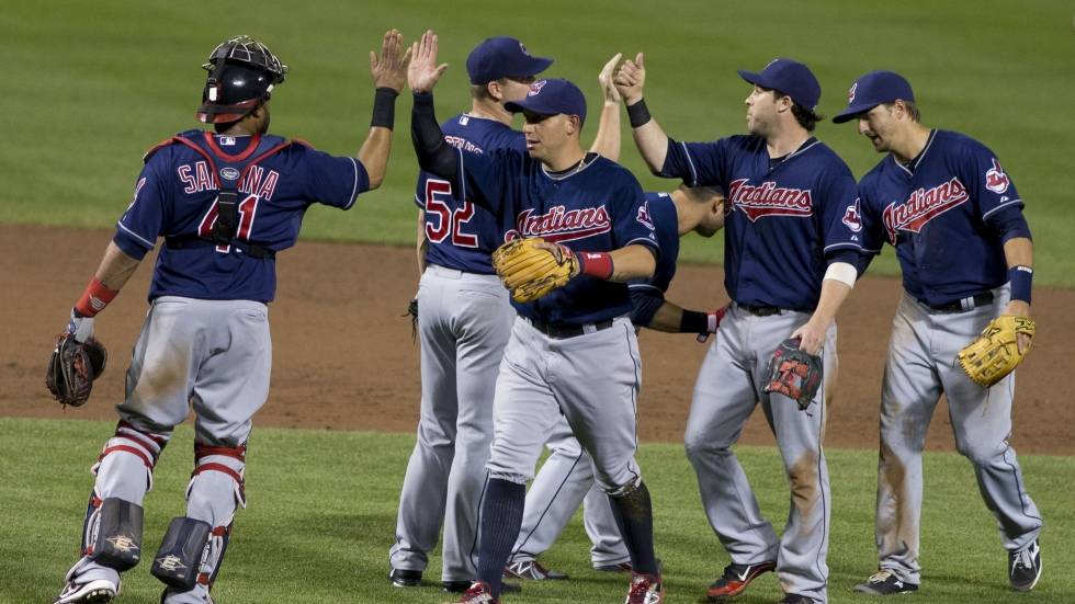 The Cleveland Indians high five each other at a game with the Baltimore Orioles June 26, 2013.