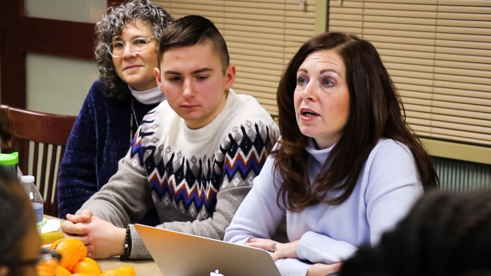 Orange High School psychologist Edie Ungar-Shafron joins junior Mark Pristash and counselor Jessica Venditti at an About Control meeting.