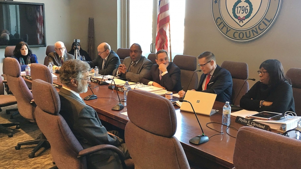 Mayor Frank Jackson sitting at council's committee table in the foreground takes questions from Council President Kevin Kelley. [Mark Urycki / ideastream]