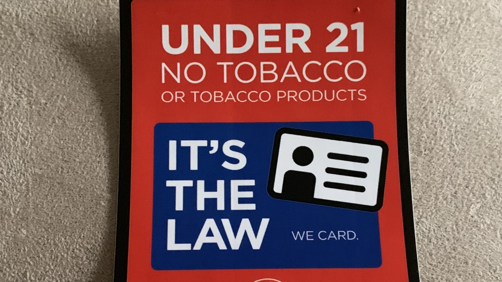 Sticker used in Akron stores where the minimum age to buy tobacco products is 21.