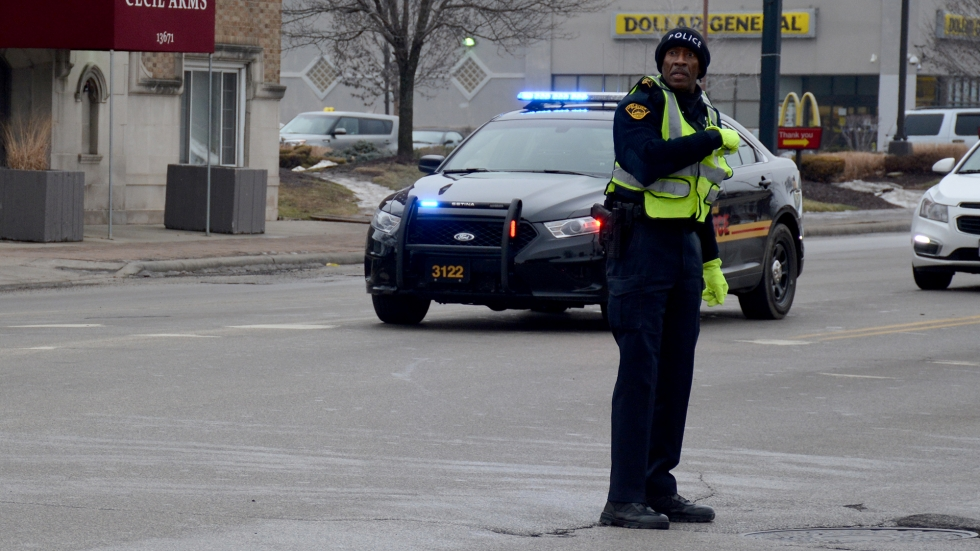 An East Cleveland police officer directs traffic at a broken stoplight in 2015.