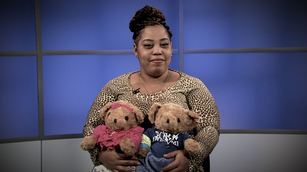 Tasha Smith holds two teddy bears containing the ashes of her lost twins, Aubrey and Abe.