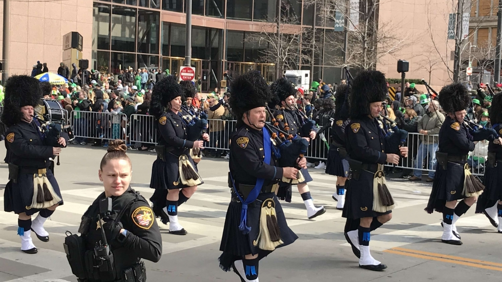 Members of the Cleveland Police Pipes and Drums march through Public Square in the 177th annual St. Patrick's Day parade, March 17, 2019. [Amy Eddings / ideastream]