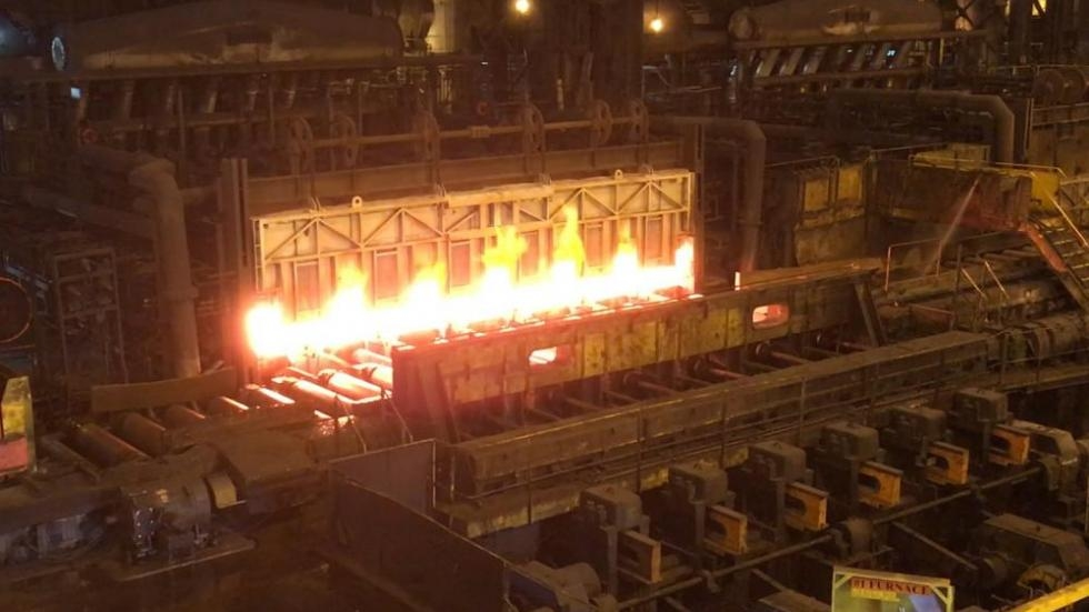 Steel slab coming out of furnace at ArcelorMittal's hot strip mill.