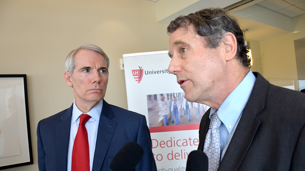 Sen. Rob Portman (L) and Sen. Sherrod Brown at a 2016 event.