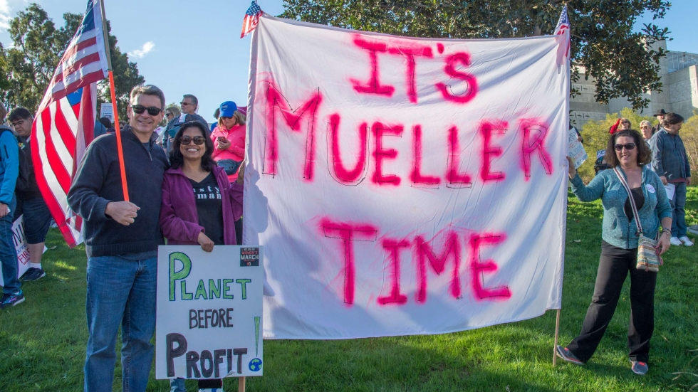 A woman's march on January 20, 2018 in Santa Ana California and government protest on the one year inauguration of President Trump. The protestors hold a sign supporting Special Counsel Robert Mueller.
